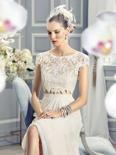 Moonlight Style J6361 French lace appliques adorn the bodice of this crop-top, two-piece wedding dress. The keyhole back finishes off this boho-chic dress.