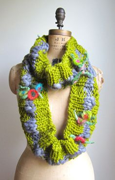 This gorgeous knit loop scarf is the perfect piece to add a bit of whimsy to your wardrobe. Very Bohemian! Handknit with two different yarns. A fabulous chartreuse acrylic mix yarn and a stunning grey wool yarn that has hand felted flowers spun right into it. This is an exquisite handspun yarn that I fell in love with on sight! This scarf measures 87.5 inches in length and 5 inches in width. Scarf can be wrapped several times to create several different looks. This loop scarf is ready t...