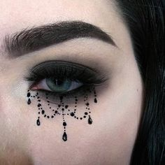 :C H A N D E L I E R: @katvondbeauty tattoo liner in trooper + shade&light eye palette + dagger from the pastel goth palette. @elfcosmetics brow pencil in deep brown. @itcosmetics no&tug waterproof gel eyeliner in black.