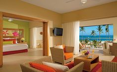 The Presidential Suite features a spacious living area and a private terrace with ocean front views at Secrets Royal Beach, Punta Cana, Dr.