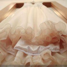 Flower girl's dress on bride's dress