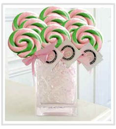 Pink and green lollipops centerpiece by Candy Spirit