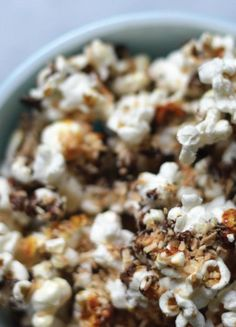 There's something about the combination of toasted coconut, caramel, and milk chocolate drizzled over yummy popcorn. You'll will discover the magic when you whip up this recipe for Samoa Popcorn!
