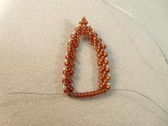 A tutorial on how to make Russian-style beadwoven leaves using St. Petersburg stitch.