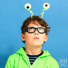 Easy-to-Make Kids' Halloween Costumes All eyes are on this alien costume. To create, paint black spots on white foam balls. Wrap with neon green pipe-cleaners and attach to a nuetral headband. Add extra twists and turns for the wackiest pair of eyes. Kids Alien Costume, Kids Costumes Boys, Halloween Costumes For Kids, Family Costumes, Diy Headband, Projects For Kids, Diy For Kids, Art Projects, Monsters