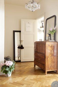 pretty room // love the herringbone wood floors