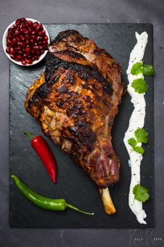 Indian Roast Lamb is a leg of lamb that has been marinated in a spicy yogurt sauce before being cooked. Great to serve with pancakes, cucumber and more.