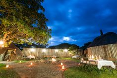 Safari dining under the African night sky at Rhino River Lodge, South Africa. Photo © Em Gatland