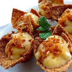 Coconut Cream Tarts - made with egg roll wrappers cut into quarters.   Allrecipes.com