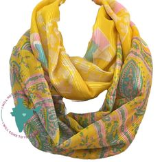 $22.00  Click twice on picture to see on Etsy. This infinity scarf was crafted from a super lightweight silk blend Indian sari. It features scattered a geometric blue and