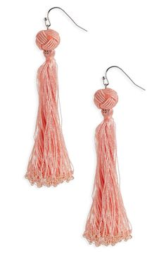 Lustrous tassels tipped with shimmery beads bring swingy movement to statement earrings with plenty of boho charm.