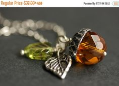 BACK to SCHOOL SALE Acorn Necklace. Amber Acorn & Green Leaf Necklace. Crystal Acorn Pendant. Orange Acorn Charm Necklace. Silver Acorn Jewe by StumblingOnSainthood from Stumbling On Sainthood. Find it now at http://ift.tt/2cvpJiA!