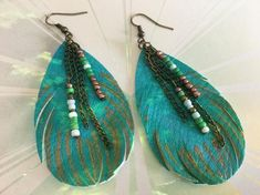 This uniquely handcrafted pair of feather earrings from Simply Charmed Jewelry are as light as a feather! The are the right size with loads of color! The bronze and aqua are a perfect match and as always they are Nickel Free! Butterfly Earrings, Feather Earrings, Handcrafted Jewelry, Earrings Handmade, Unique Jewelry, Women Jewelry, Fashion Jewelry, Sparkly Jewelry, Leather Jewelry