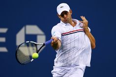 Andy Roddick of the United States returns a shot during his men's singles fourth round match against Juan Martin Del Potro of Argentina on Day Nine of the 2012 US Open