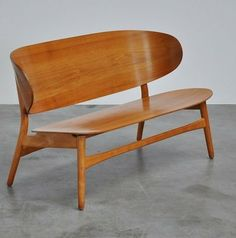 I covet this for a kitchen banquette .... Hans Wegner; Beech ant Teak Settee for Fritz Hansen, 1952.