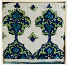 Tile | Made in Damascus, Syria, ca. 1550-1600 | Materials: fritware with underglaze polychrome painting | Tile (border tile from a freize), fritware, square, painted in underglaze blue, black, turquoise and sage green with a section of a shaped parapet filled with arabesque designs alternating with trefoil motifs | VA Museum, London