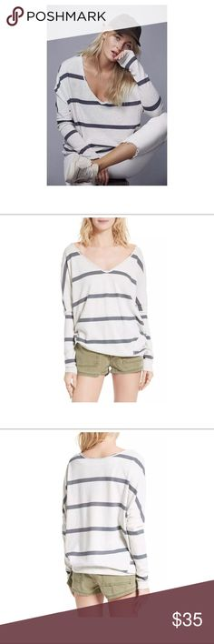 "$68 NEW Free People 'Upstate' Striped Tee ~Size S $68 NEW Free People 'Upstate' Striped Tee ~Size S~  New without tags. Retails for $68 + Tax  Ivory/Gray stripes Long sleeve Over sized Deep V neck  Size S  Measures approximately: front length 29"", back length 31""  bust across 27""  High end department store shelf pull- new without tags. May have had customer contact *There is some white threading on one of the gray stripes- shown in photos.   PLEASE ASK ANY QUESTIONS BEFORE PURCHASE, THANKS…"