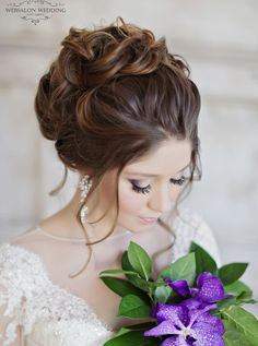 Gorgeous updo wedding hairstyle; Featured: Websalon Weddings
