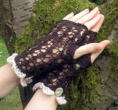 Hand knitted lace fingerless gloves in brown with cream edgings and mother of pearls button