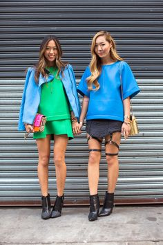 Aimee from Song of Style & her sister, Dani, wearing black booties & bright colors during NYFW