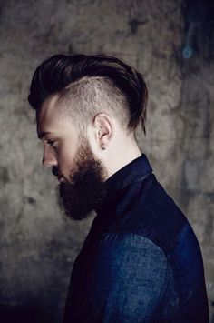 Classic disconnected haircut with a long pompadour top