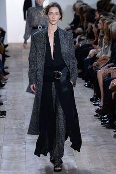 Michael Kors F/W 2014, grey coat, grey loose pants, long black shirt, leather belt, sandals / Garance Doré