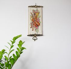 Antique Hand Embroidered Wall Decoration with a trumpet, violin and flowers by ScandicDiscovery on Etsy