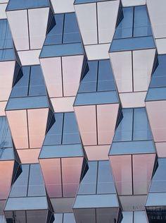 Trapezoidal glass panels create prismatic facades for SOM's Beijing skyscraper
