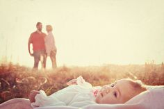 I feel like this picture had good intentions but all I see is two parents who left their child in a field