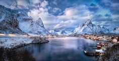 Dreaming of Reine - Probably the most famous view on all of Lofoten islands, and with good reason. The incredibly picturesque setting of Reine on Moskenesøya, the outermost island accessible by road. It has been photographed a million times. Here you see my interpretation: A cold and quiet winter afternoon when it was just late enough for the village lights to turn on but still quite some time before blue hour... what I started to call the 'pink hour' because of the sometimes almost eerie…