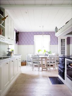 Swedish style - love that little inlay flooring in front of the stove