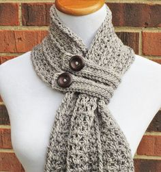 The Hartford Buttoned Scarf is a beautiful, lacy scarf featuring a unique construction, extra-long fringe and two trendy button bands to keep it snug and [. Crochet Scarves, Crochet Shawl, Crochet Stitches, Knit Crochet, Crochet Patterns, Crocheted Scarf, Hand Crochet, Knitting Patterns For Scarves, Crochet Ideas