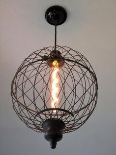 New meets vintage style! Just like our small version!Made with a weathered and distressed black metal wire that looks like it is an antique. This would make a
