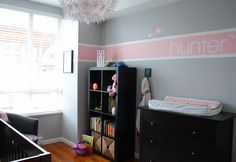 Love this paint color as alternative to traditional pink nursery - gray with pink accent line. Paint color: General Paint (Grey: Threshold Grey; Pink: Ginger Pink)