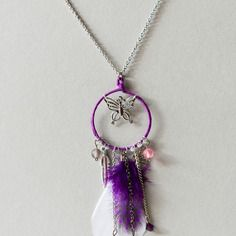 "Collier long ethnique ""papillon"" violet"