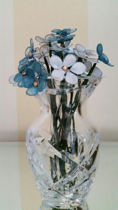 My first effort with wire, nail polish and crystals. Wire nail polish flowers..