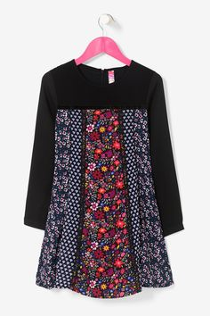 Desigual girls' long-sleeve black dress with various prints on the chest and the skirt. Discover more about Desigual Kids collection!