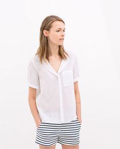 Image 1 of BLOUSE WITH POCKET from Zara