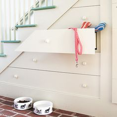 Deep drawers tucked under treads provide storage for pet supplies and other sundries. Built just like an old furniture piece, the boxes glide on wood guides and are faced with angled fronts that fool the eye. | Photo: Alan Shortall/Cornerhouse Stock | thisoldhouse.com