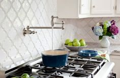 Beveled Arabesque Tile backsplash, and the spout at the stovetop area.