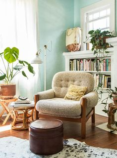 Relaxed Bungalow in Portland, Oregon Aqua walls, white paint built-ins, plants, comfy chair Home Decor Inspiration, Living Room Green, Interior, Home, Luxury Chairs, Bungalow Decor, House Interior, Home Interior Design, Interior Design