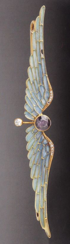 An Art Nouveau gold, enamel, amethyst and diamond Wings brooch, circa 1906. Previously attributed to Hoeker, Amsterdam. 1.5 x 8.8cm. Source: Wolfgang Glüber, Jugendstilschmuck #ArtNouveau #brooch