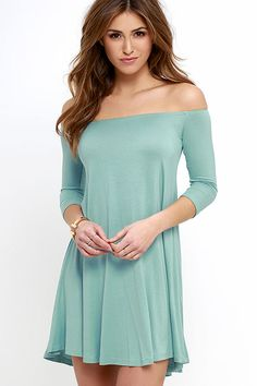 When the Hold the Phone Seafoam Swing Dress comes calling, you're definitely going to want to pick it up! Lightweight jersey knit falls from an elasticized, off-the-shoulder neckline, framed by fitted half sleeves, into a flirty swing silhouette.
