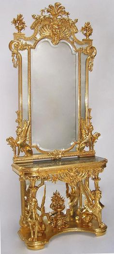 """A Very Fine French Empire 19th Century Napoleon III Gildwood Carved Figural Console Table with Matching Mirror, the """"D"""" shaped top console raised by a pair of sitting winged sphinxes with notched corners over a conforming frieze centered by a pierced carved Satyr's mask with foliate swags above a mirrored trefoil backboard centered by a flowering urn adorned by chimera, raised on a shaped base, fitted with a Verde d'alps marble top. The figural mirror flanked by a pair of sitting winged sphinxes, with carved scrolls, garlands and crowned with a pierced carved Satyr's mask with foliate swags and accanthus, the top with a pair of floral urns. All gilding is the original 24ct gold leaf. Circa: Paris, 1870"""