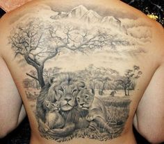 incredible black and grey lion family tattoo on the background of savannah and mountains