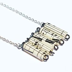 cool idea: sheet music into paper beads into jewelry