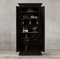 RH's stately Castelló double-door cabinet is the perfect accent in a tall-ceilinged room; $4,995. rh.com