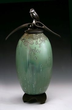 """"""" Quite Solitude"""" by Debra Steidel - Although they look like bronze, each of the lids on top of the jars are sculpted with porcelain and fired with a metallic glaze."""