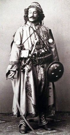 A Kurdish Noble by Pierre De Gigord - 1865, shown with shamshir sword and shield.