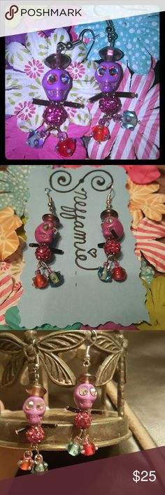 Dia de Los Muertos earrings Handcrafted with a funky twist, these earrings are a fun conversation starter!! The Reconstituted stone skulls have Swarovski embellishments.  The bodies are constructed with wire, acrylic and glass beads.  Also, these little guys are very lightweight! Sneffamie Jewelry Earrings